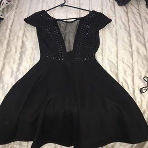 Low black mini dress